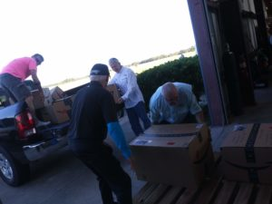 Faith Riders unloading cargo they brought for the Fire Dept in the Bahamas who don't have beds to sleep on